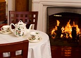 Tea set on a table by a fireplace in a York Harbor lodging