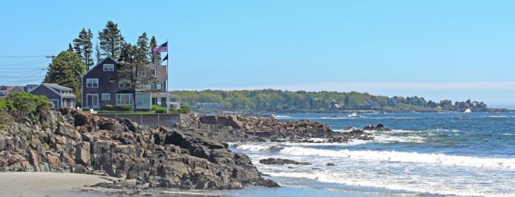 Beach in Maine with beach house in the background.