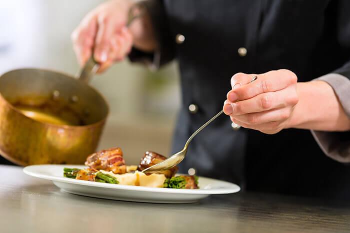 Chef platting dinner