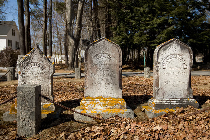 close up of headstones in a Maine graveyard