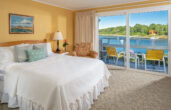Room 119 bed and water view at our York, ME hotel