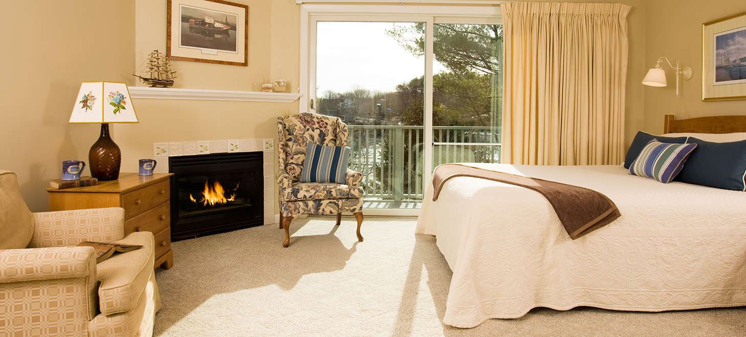 Guest room with bed and fireplace