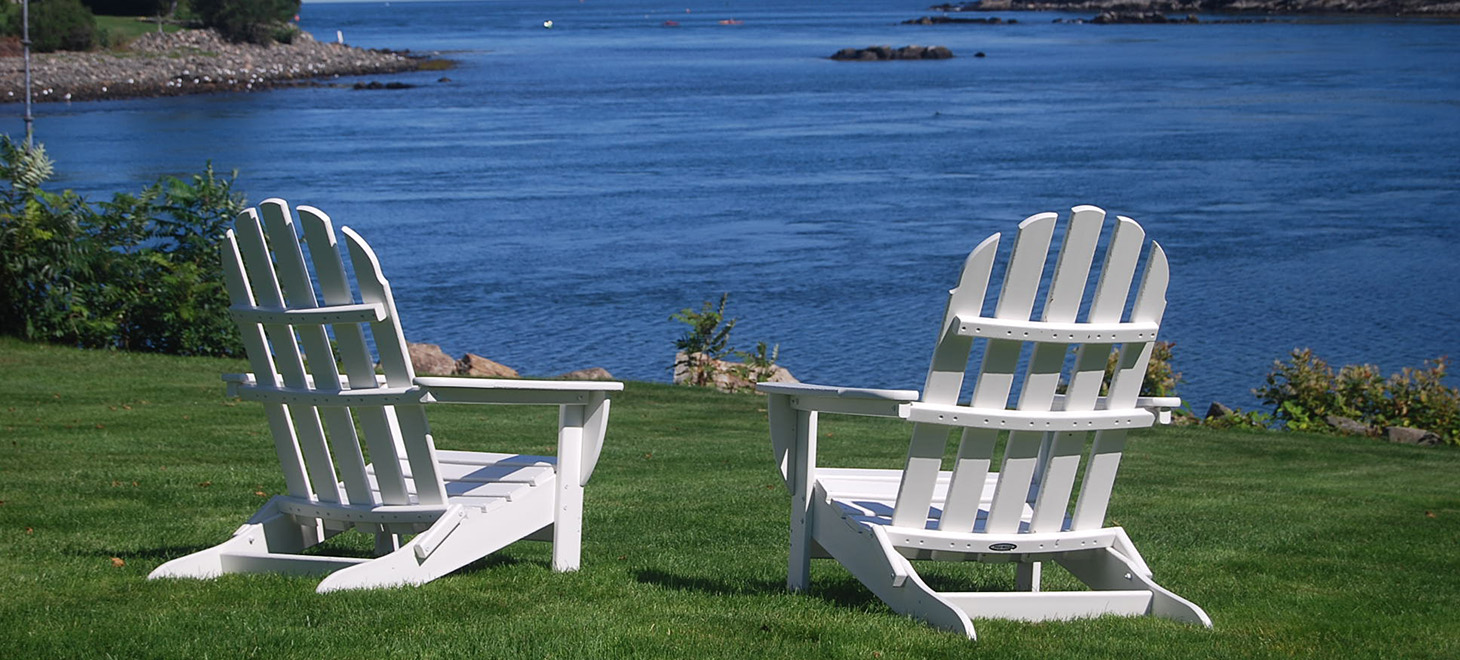 chairs on lawn overlooking ocean