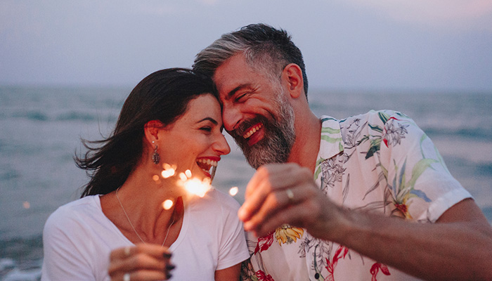 couple on the beach with sparklers